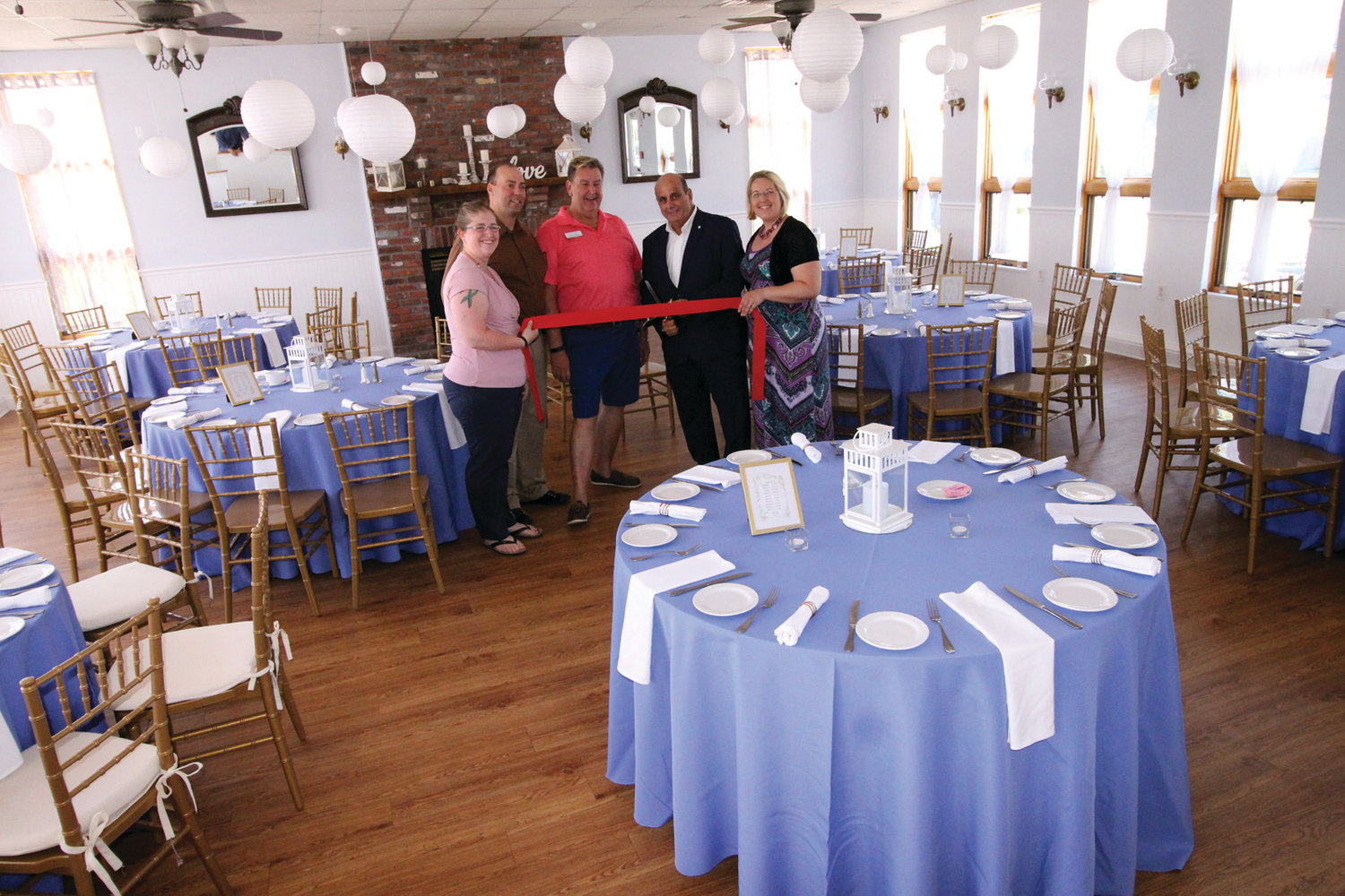 EVENTS VENUE: Christine Tadaro, catering manager, Mike Vierra, general manager, Mark Brown, catering and event director, Mayor Solomon, and Tori Jessop, sales and event planner in the main room of Cozy Caterers on Bay Avenue in Oakland Beach.