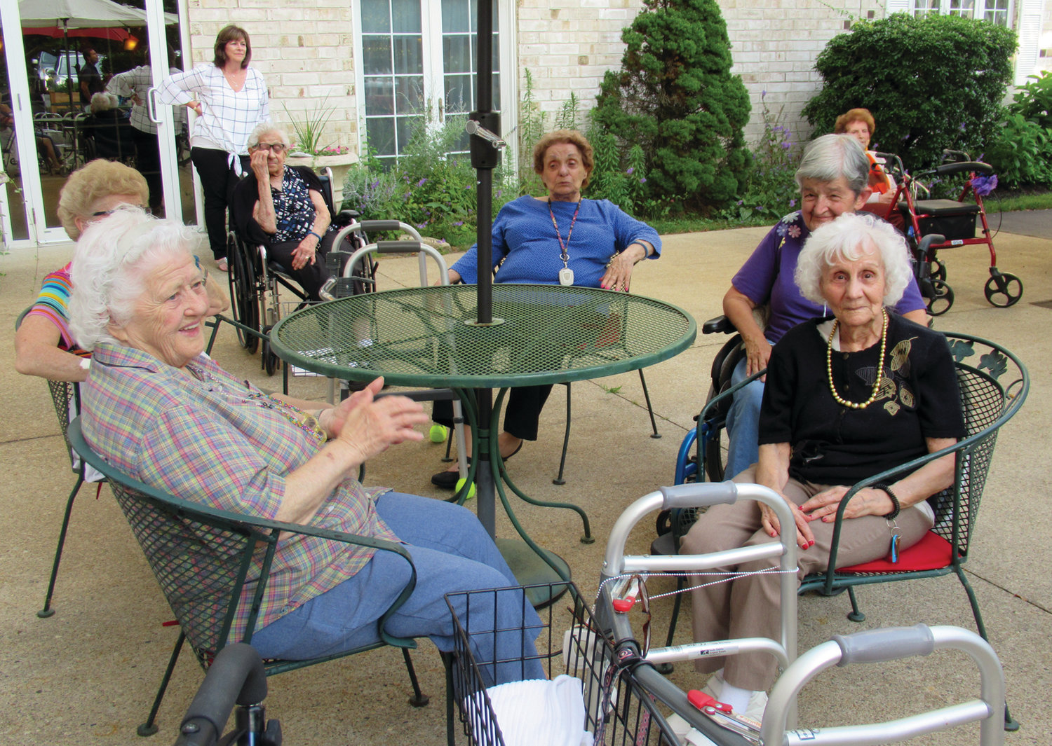 SPECIAL SEATS: The Bridge at Cherry Hill residents like Dorothy Branch and Jane Cimaglia had special seats for Tuesday night's first of four free summer concerts in Johnston.