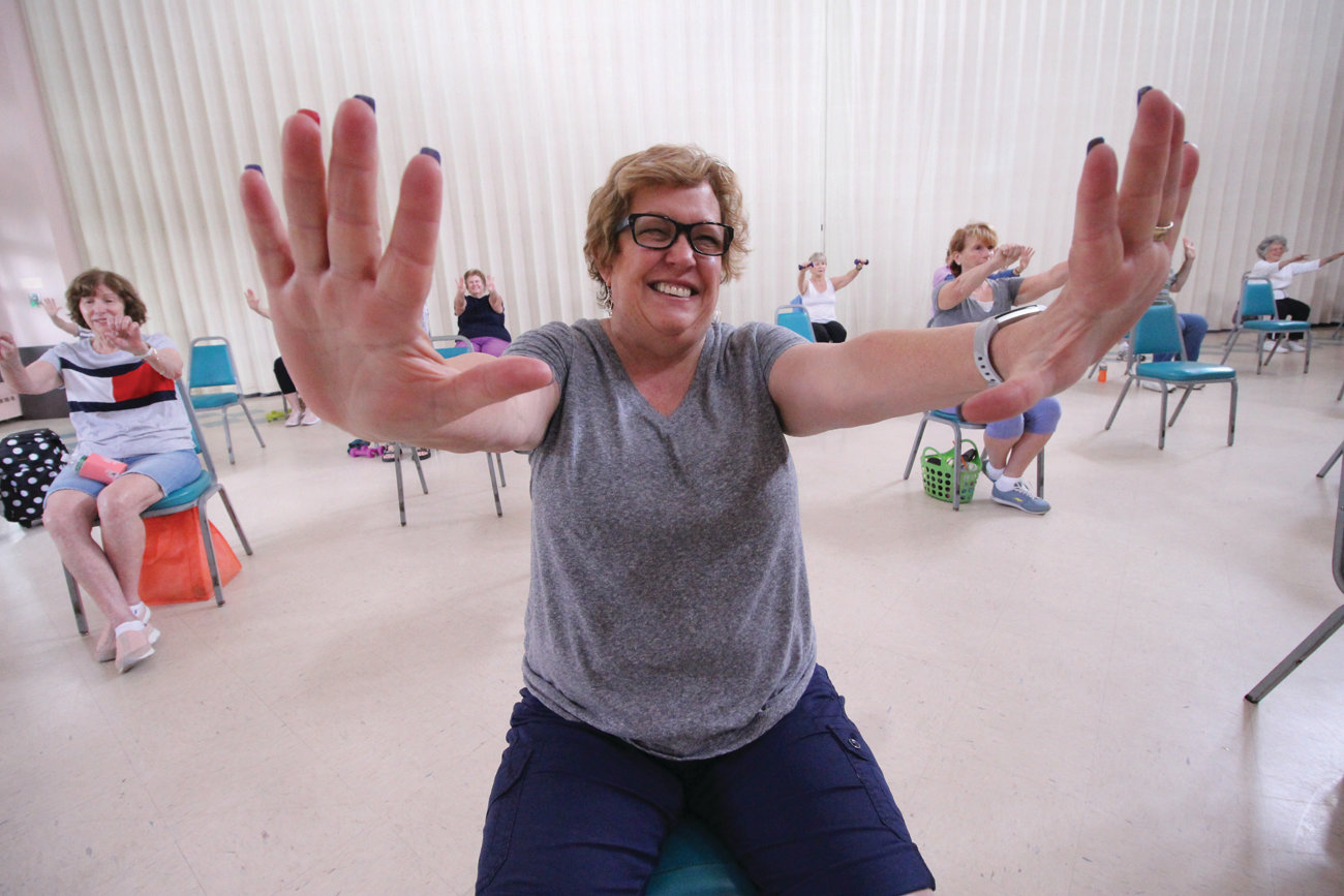 HAND UP: Kathy Cordeiro, 64, of Warwick stretches her arms out as part of one of the exercises. She finds the program very beneficial.