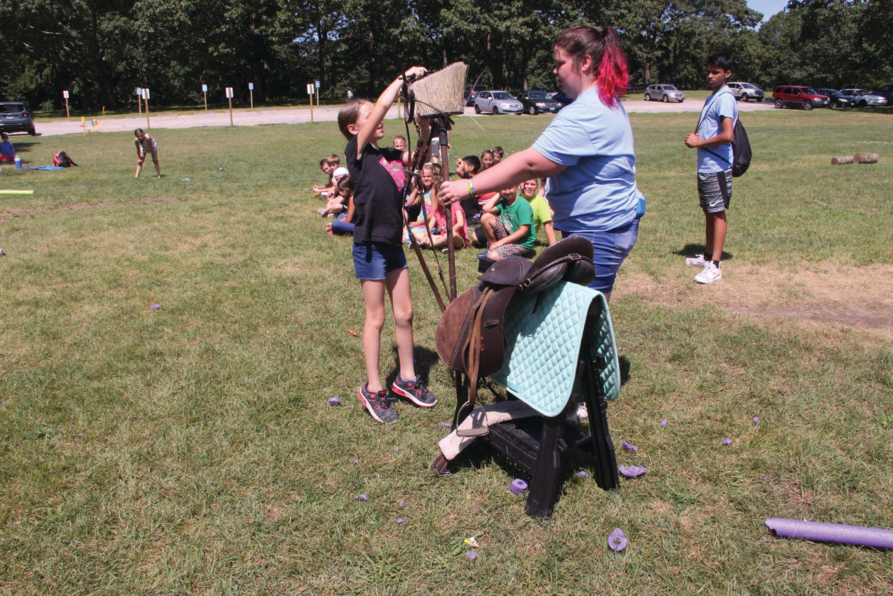 IMAGINE A HORSE: Campers working together in a relay team saddled up a sawhorse as part of an exercise run by the Future Farmers of America.