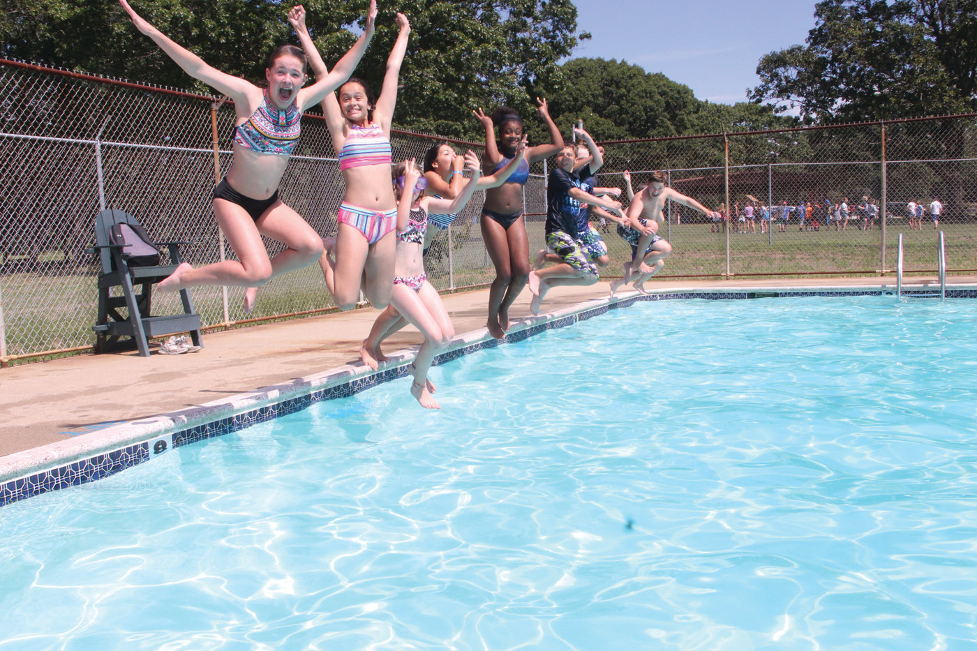 ON THE COUNT OF THREE: It didn't take any coaxing for these Boys and Girls Clubs of Warwick summer campers to leap into the pool at the Masonic grounds.