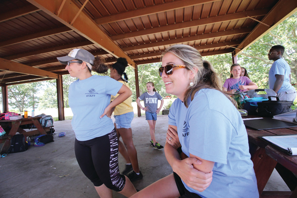 KEEPING TRACK OF IT ALL: Arianna DeAngelis, director of the Club at Cooper, and Nicole Spirito, director of the Norwood Club and the summer camp, keep a watchful eye on the Boys and Girls Clubs of Warwick summer camp.