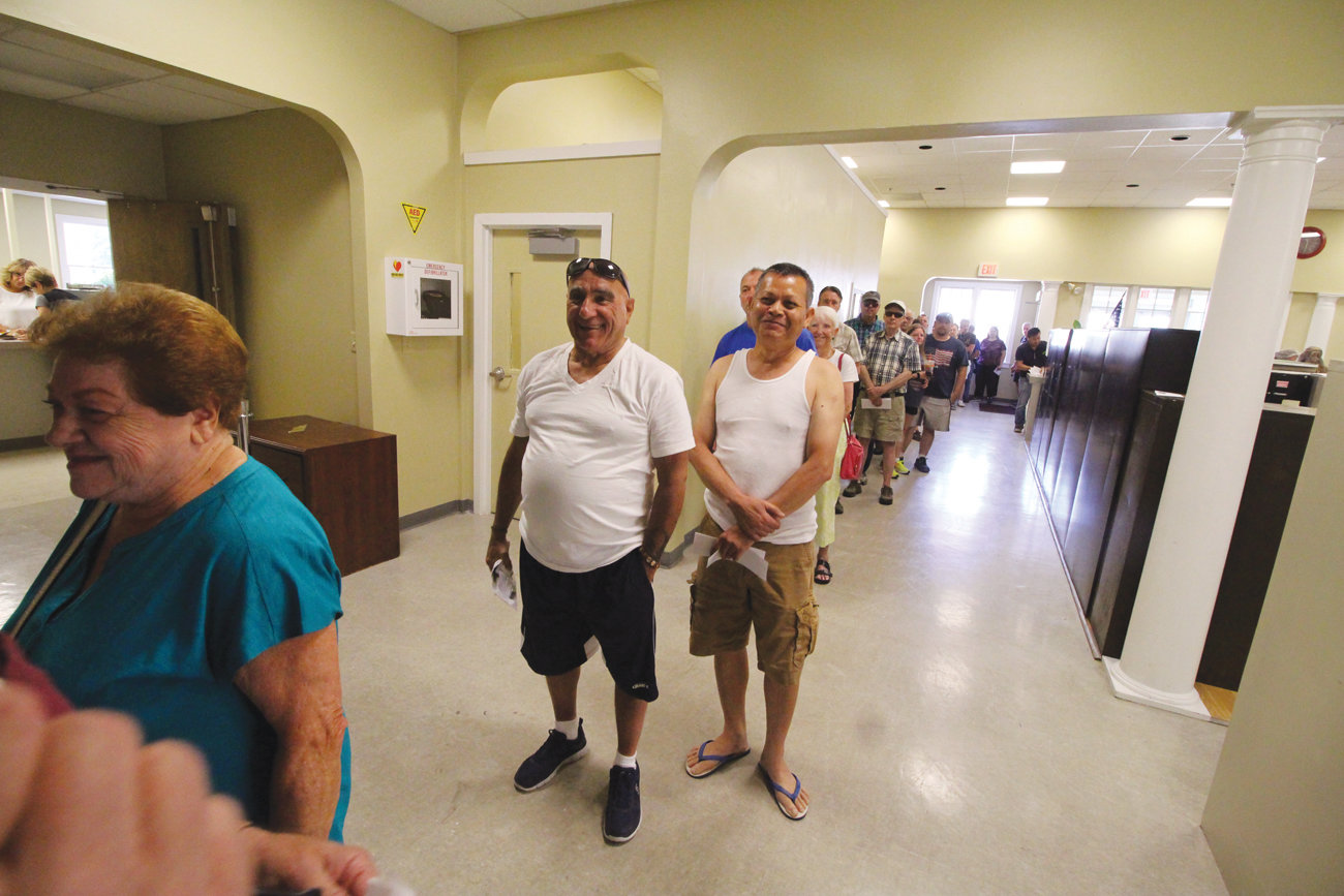 WAITING TO PAY: While the line was often 30 and 40 deep, it wasn't an overly long wait for taxpayers Monday at the Tax Collector's office at the Buttonwoods Community Center Monday morning.
