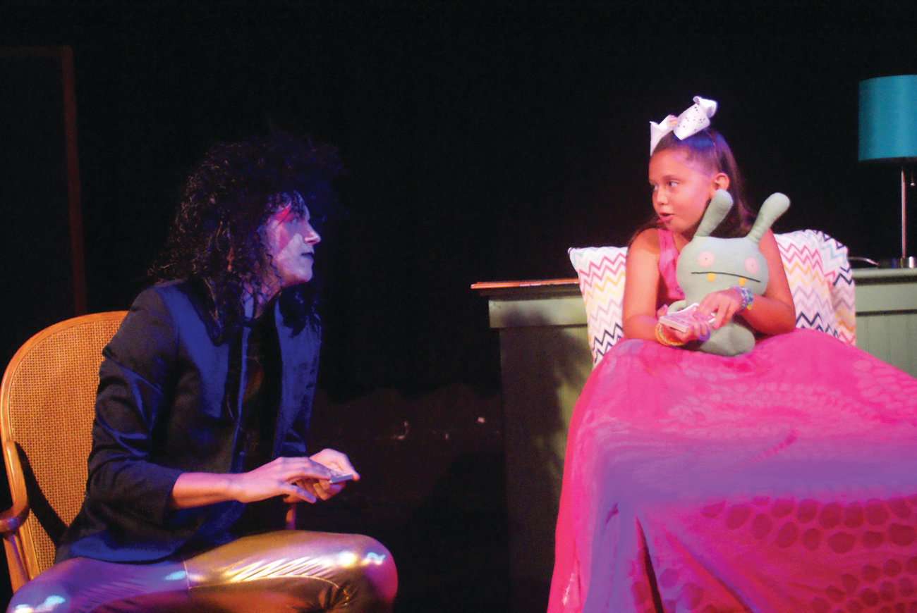 "MONSTER UNDER THE BED: Adriana Albanese, 7, gave a heart-warming performance in ""Monster Under The Bed."" She is pictured with the monster, played by Kyle Martin Clark."