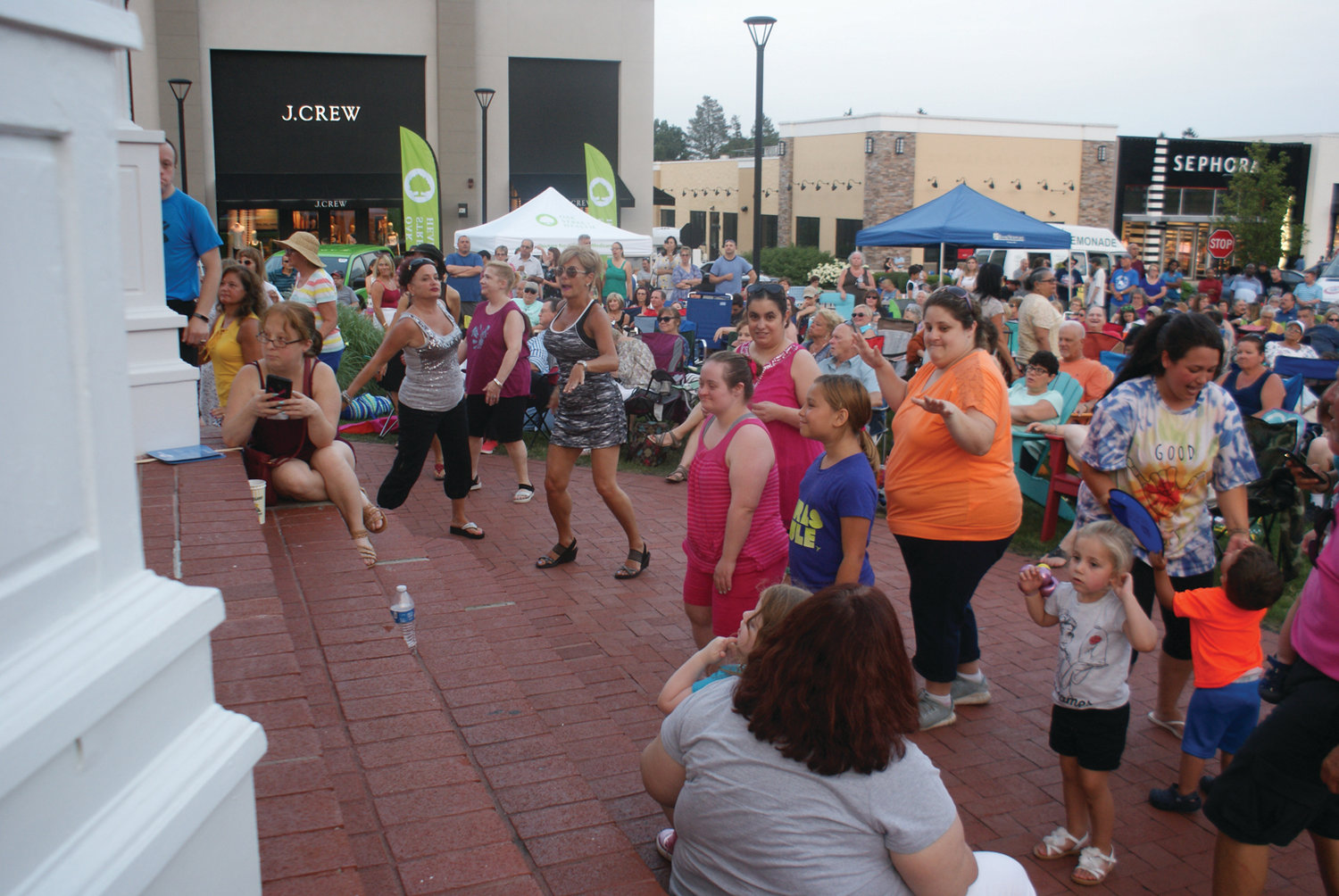 DANCE PARTY: It never fails that the audience during the Garden City Summer Concert Series gets up to dance.