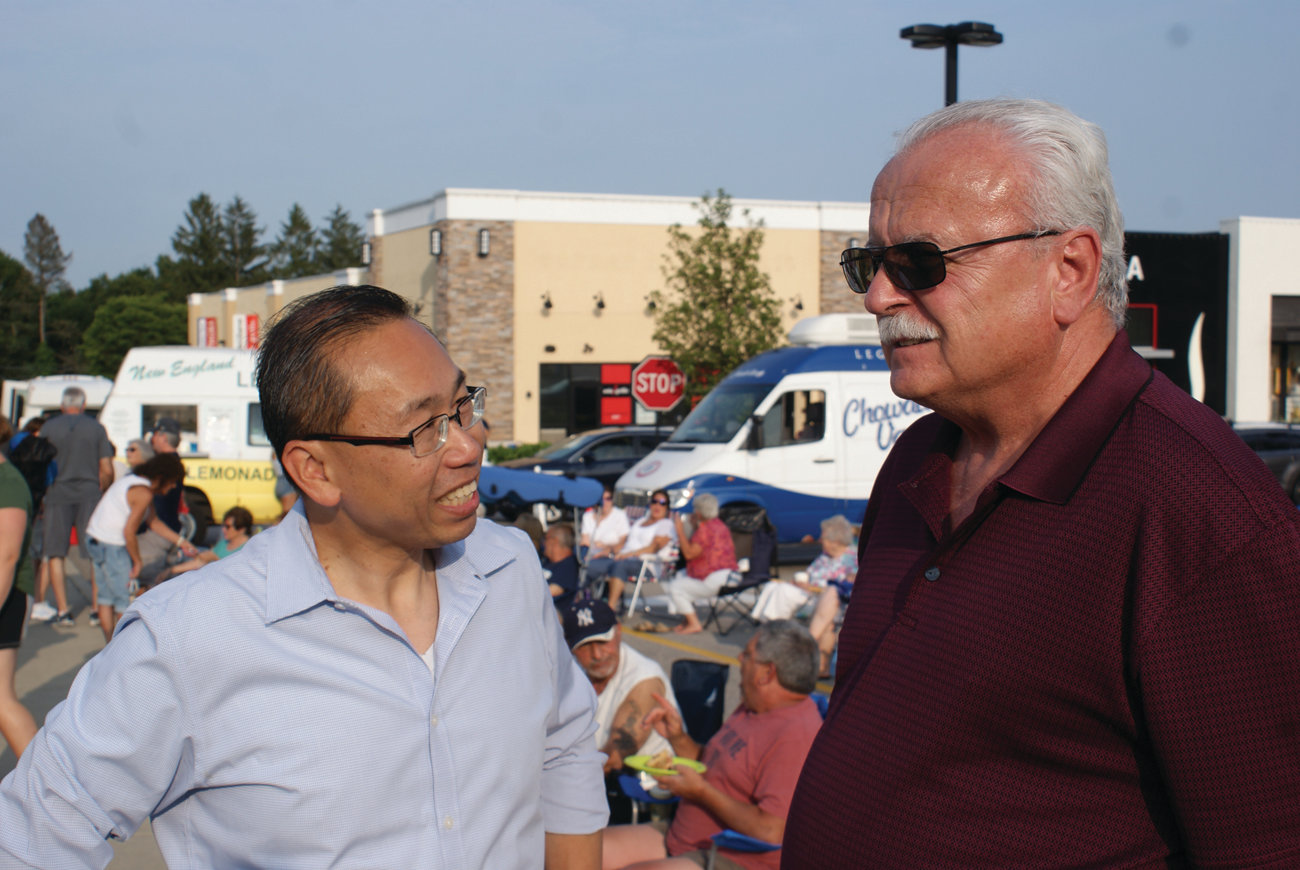 NEVER MISS A BEAT: Cranston resident Donald Denham Jr. enjoyed speaking with Mayor Allan Fung during the kickoff of the Garden City Concert Series on July 10. Denham has been attending the concerts for the past 23 years.