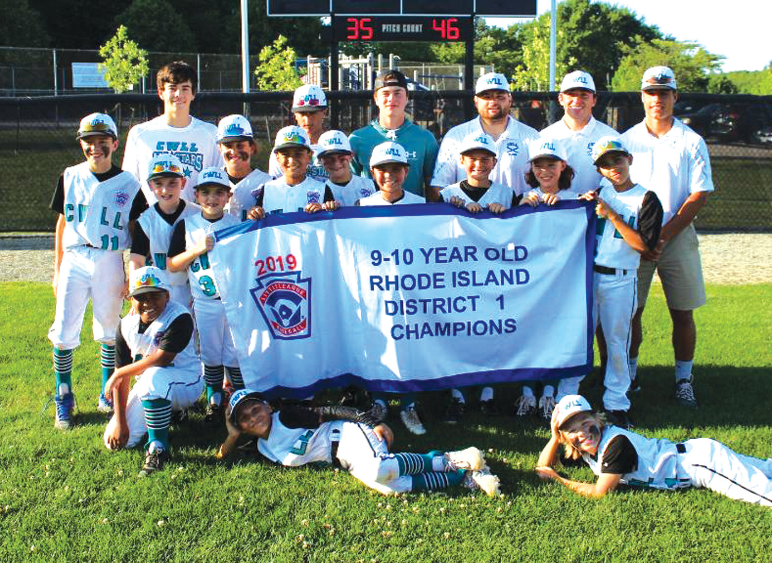 BIG STAGE: The Cranston Western 10's celebrate after winning the District I title over North Providence last week.