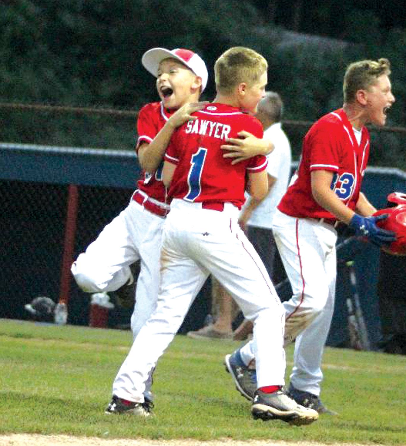 CELEBRATE GOOD TIMES: Members of the WCA 10's celebrate after winning the District 3 title.