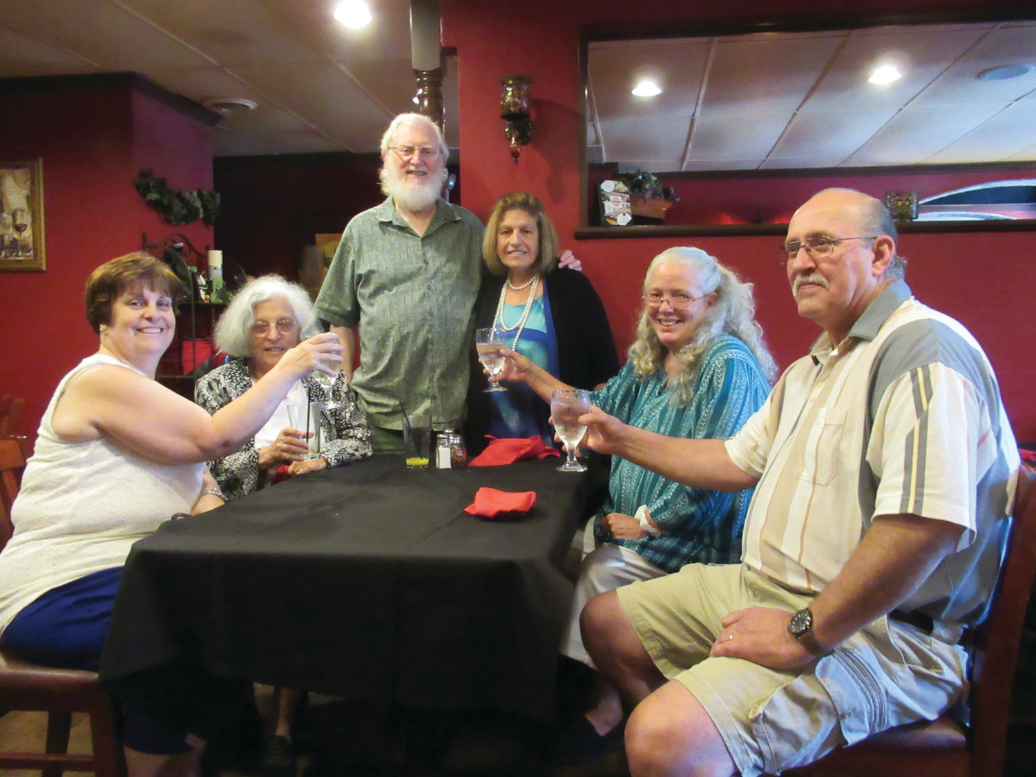 FAMILY FRIENDS: Louis McGowan, right, is joined by Rico Razza, his sister Adrienne McGowan, Warren and Ellen Lanpher and his wife Bel McGowan during a surprise birthday brunch.