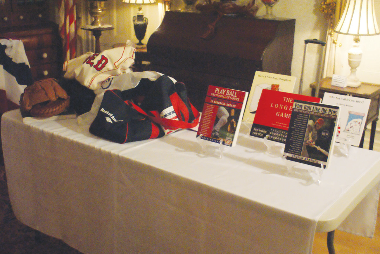 MEMORABILIA: Steven Krasner brought along some sports memorabilia and displayed several of his books.