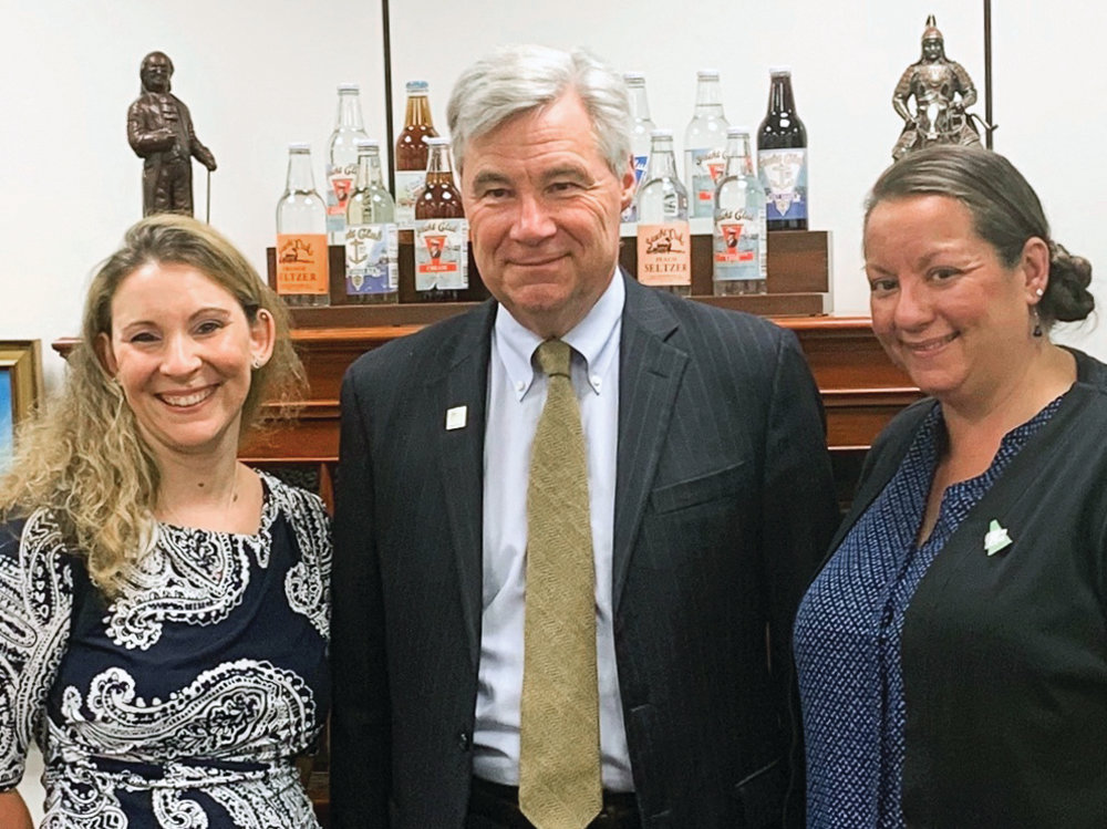 VISIT WITH WHITEHOUSE: Melissa Ames, left, and Michaela Cook share a moment with U.S. Sheldon Whitehouse during their advocacy trip.