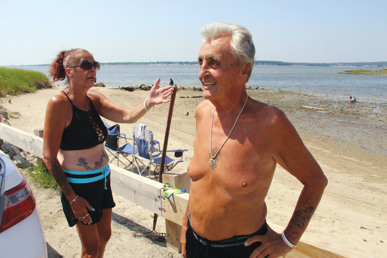 A FAVORITE PLACE: Barbara Angel and Bobby Mandarelli of Johnston are regular visitors of the beach overlooking Brush Neck Cove and Greenwich Bay. (