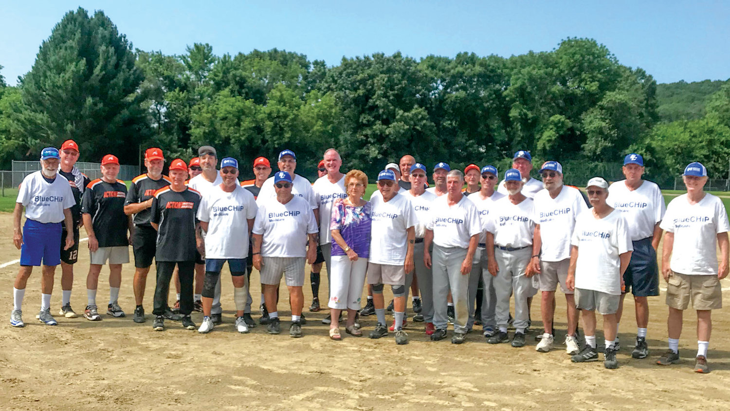 SECOND FAMILY: Members of the RI Senior Softball League, including the Blue Cross team, during a game this season.
