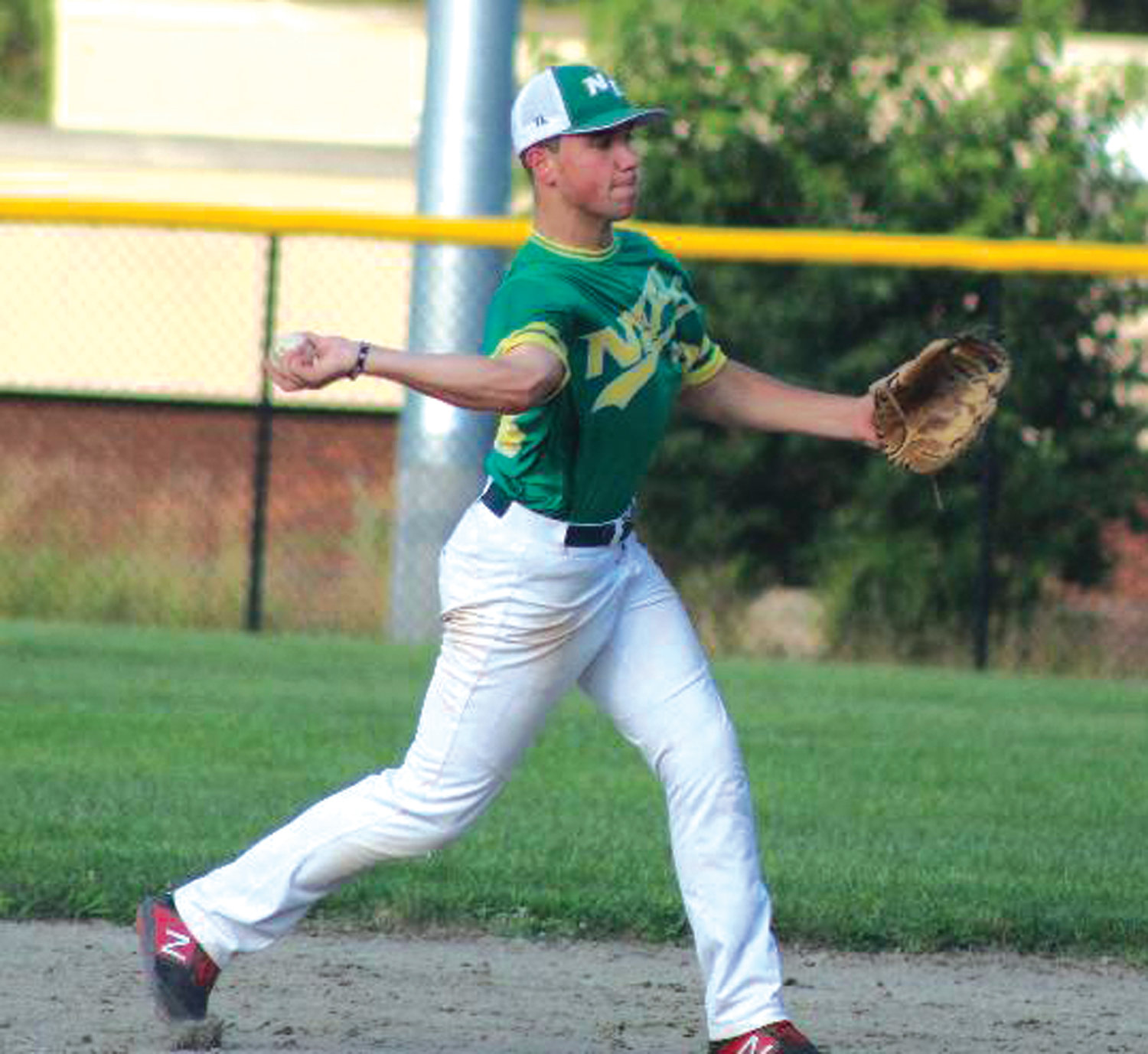 PLAYING THE FIELD: NEFL's Christian Rapoza fires to first base in Woonsocket.