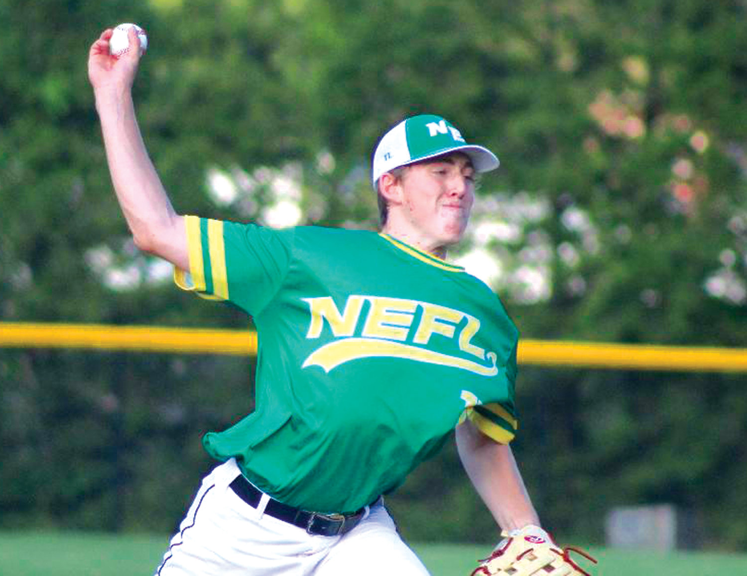 ON THE HILL: NEFL pitcher Jack Gannon deals against Navigant.