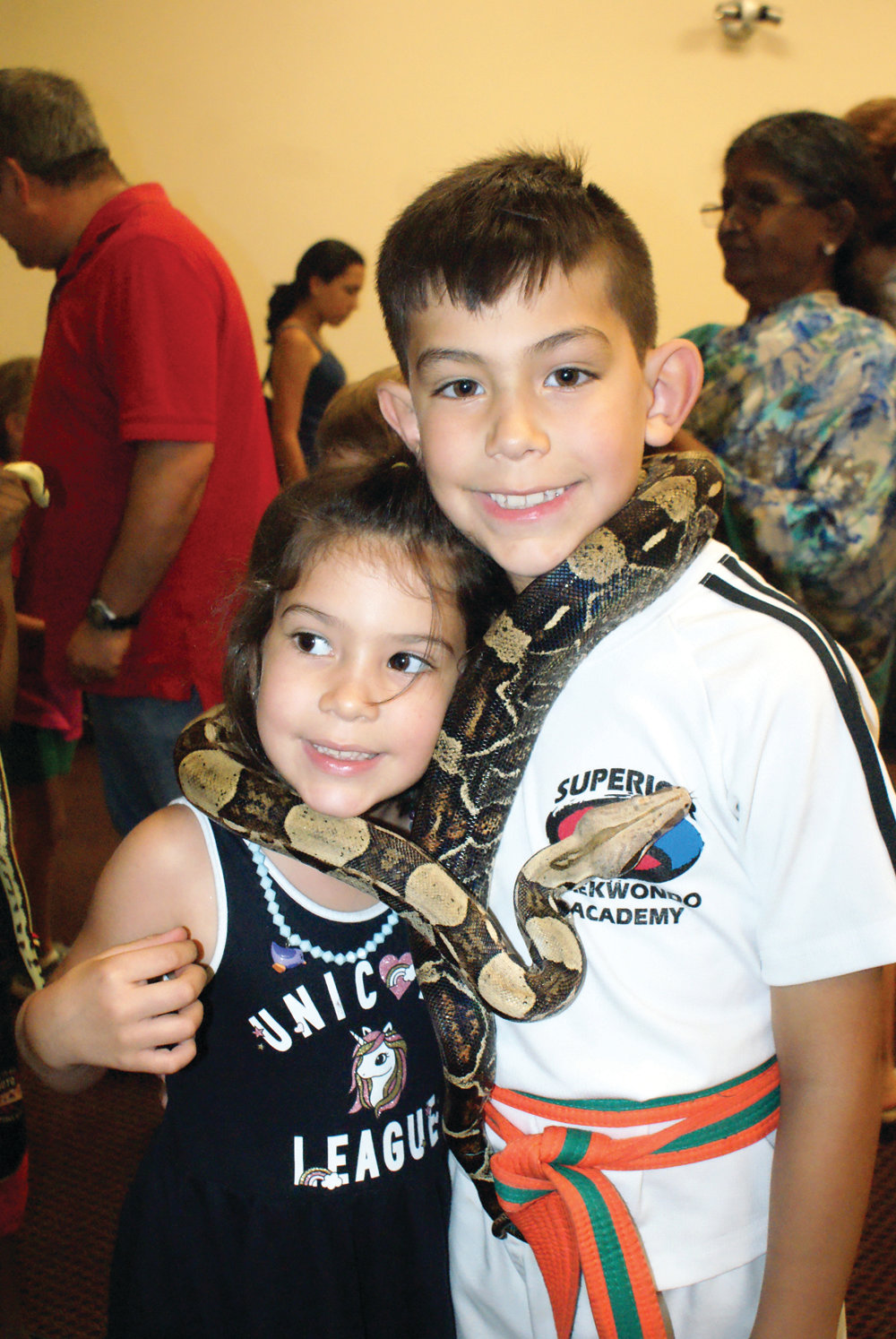 SIBLINGS AND SNAKE: Sharing an experience with Rollo, a boa constrictor, were the McGee siblings – Isle, 6, and Declan, 8.