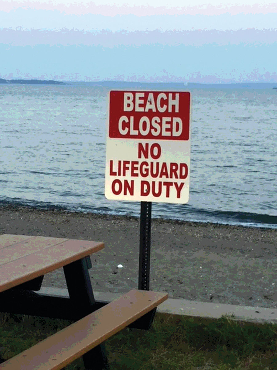 MAKE APPEARANCE: The city erected signs at the two Rocky Point beaches Tuesday indicating they are closed and there is no lifeguard on duty. The beach closure notice has since been remove, the mayor's office reports.