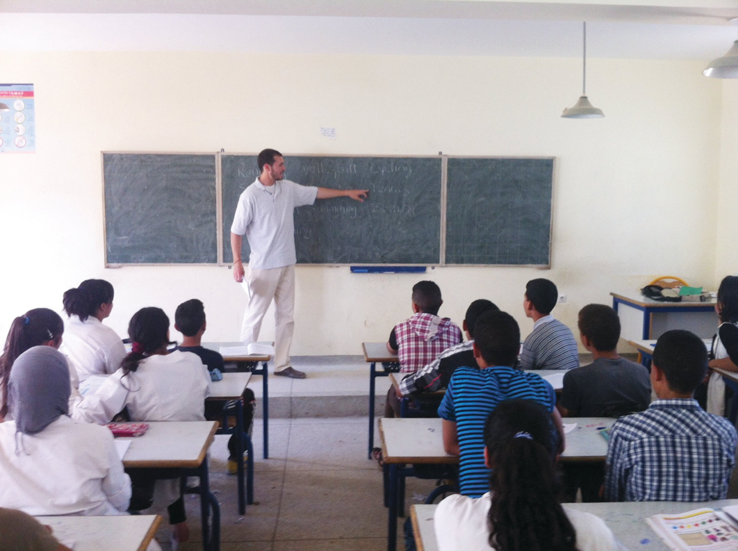 Justin Bibee leads a classroom during his time as a Peace Corps volunteer in Morocco.