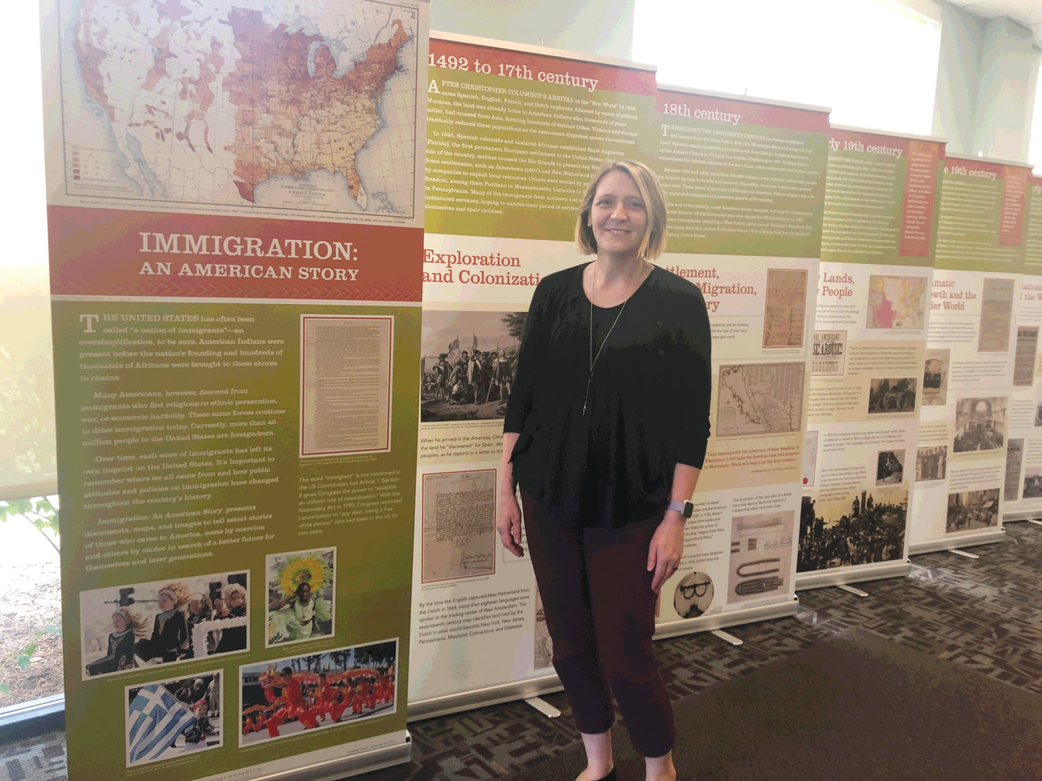 HISTORY MATTERS: Jana Stevenson, Deputy Director of the Warwick Public Library, hopes that the library's exhibit will encourage patrons to share their own experiences with immigration and appreciate Rhode Island's diverse history.