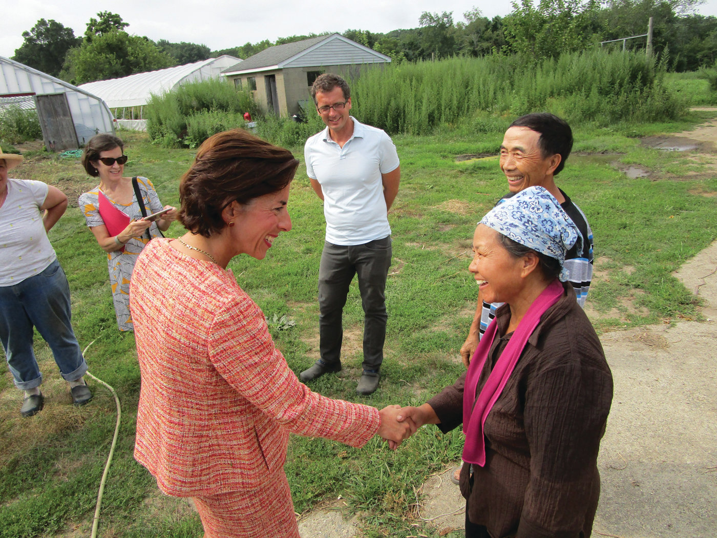VISIT FROM THE GOVERNOR: Gov. Gina Raimondo greets Kia Xiong and her husband, Choua, during her visit to Urban Edge Farm on Tuesday. The Xiongs operate Greenleaf Farm and are among the growers for Sanctuary Herbs of Providence.