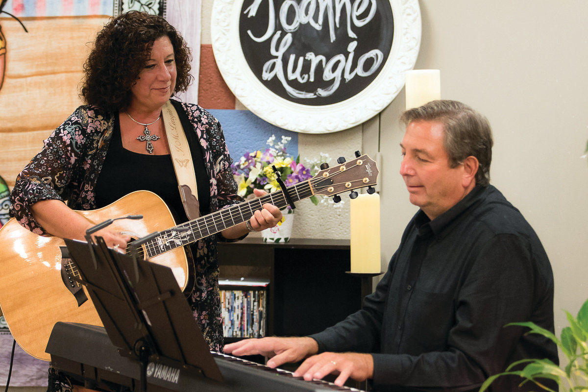 "MAKING MUSIC: Joanne Lurgio rehearses with Bryan Barrette, music director at St. Kevin's Church and her accompanist on ""Crossing Jordan."""