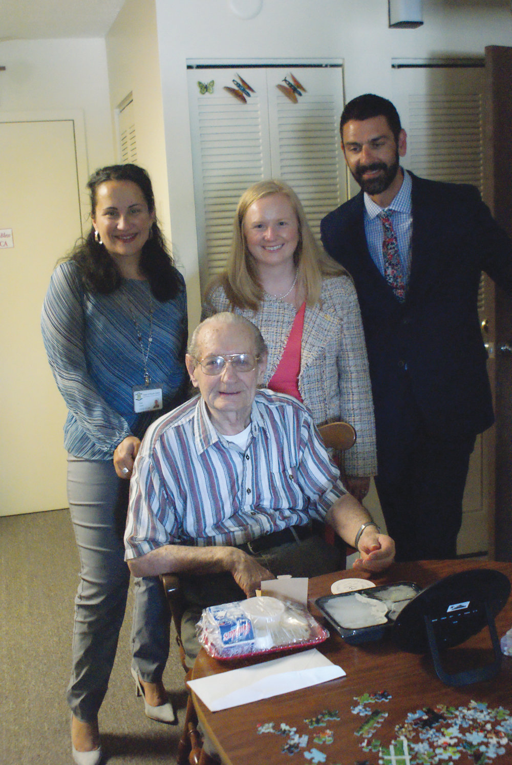 SPECIAL DELIVERY: Receiving the 19-millionth meal from Meals on Wheels of Rhode Island during a recent visit was 88-year-old Joseph Brisson of Cranston. He is pictured along with Rose Amoros Jones from the state's Office of Healthy Aging and Meghan Grady and Kevin Millonzi from Meals on Wheels.