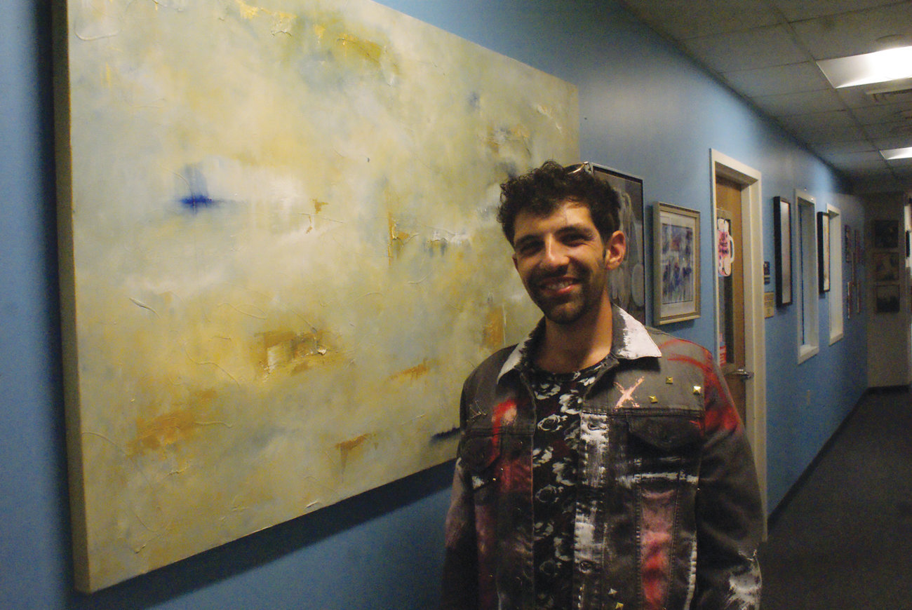 "MAKING AN IMPRESSION: Zach Prosser of Warwick had success with his first showing at the New Hope Art Gallery in Cranston. He is pictured with his painting, ""Cloudy Day,"" which he sold to a man from Newport for $800."