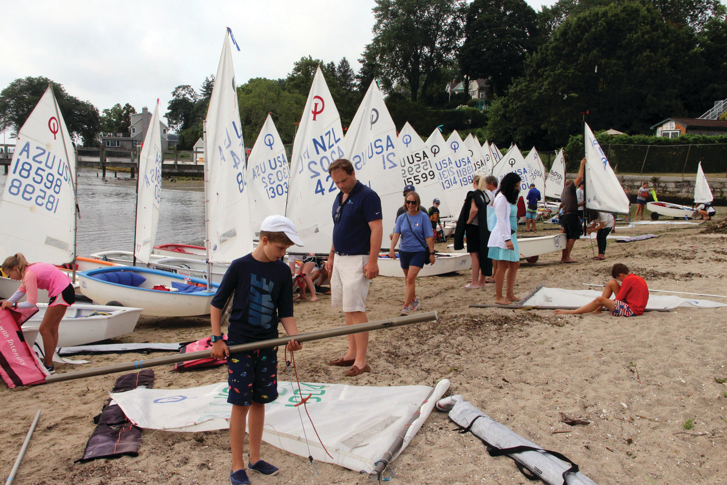 READY TO LAUNCH: Optis line the beach at the Edgewood Yacht Club in preparation for Wednesday's regatta.
