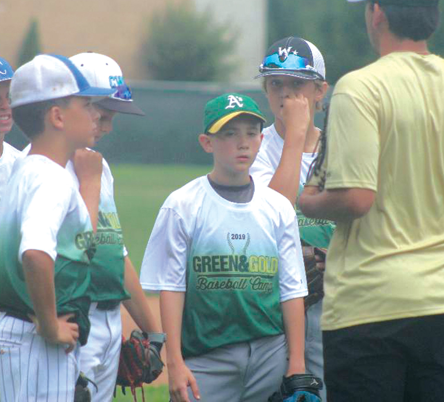 COACHING UP: Campers  take instruction at camp.