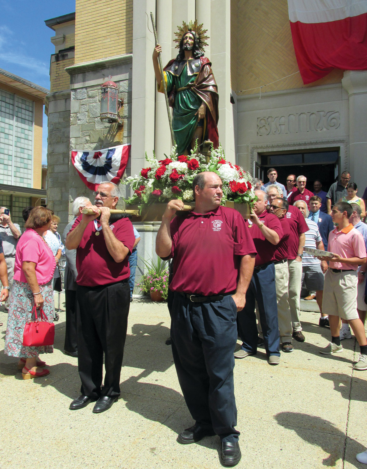 SPECIAL STAFF: Saint Rocco's Feast and Festival co-chairman Richard Montella, front left, and members of the Johnston parish will carry the statute of the patron saint during the annual procession through the streets on Sunday, Aug. 18, in Johnston.
