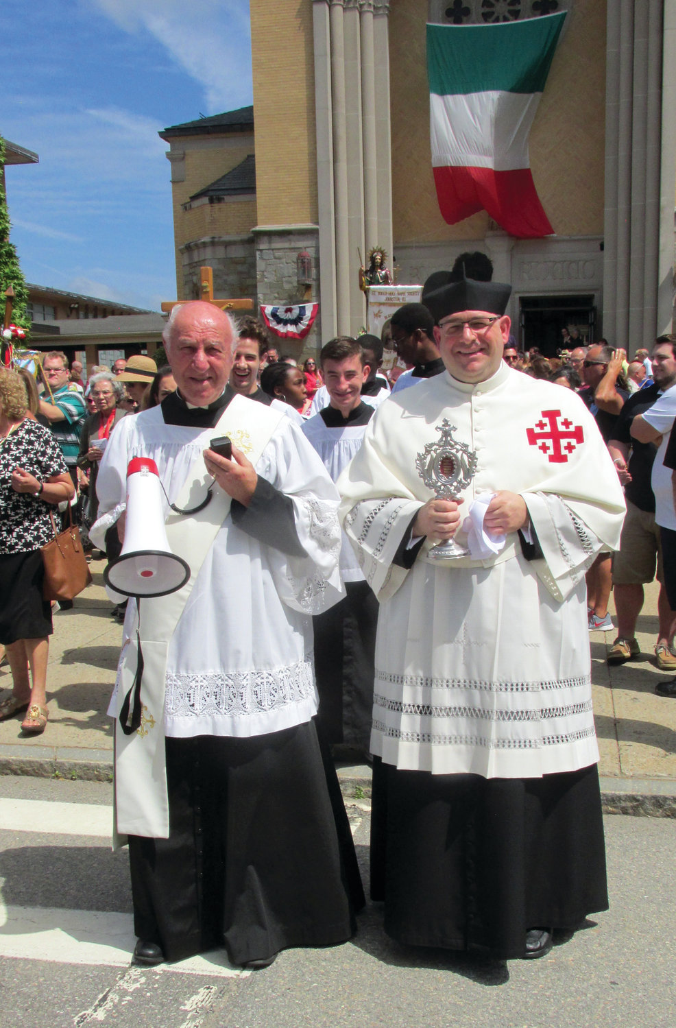 DELIGHTFUL DUTY: The Rev. Angelo Carusi, right, pastor at Saint Rocco's Church in Johnston, will be offering special blessings during the century-old procession after the 11 o'clock solemn Mass on Sunday, Aug. 18.