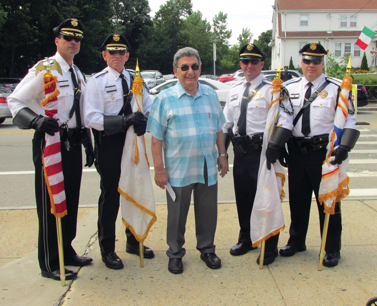 PROUD PATROL: John Ricci, center, co-chairman of the Saint Rocco's Feast and Festival, thanks the Johnston Police Color Guard for leading the procession during last year's festivities.