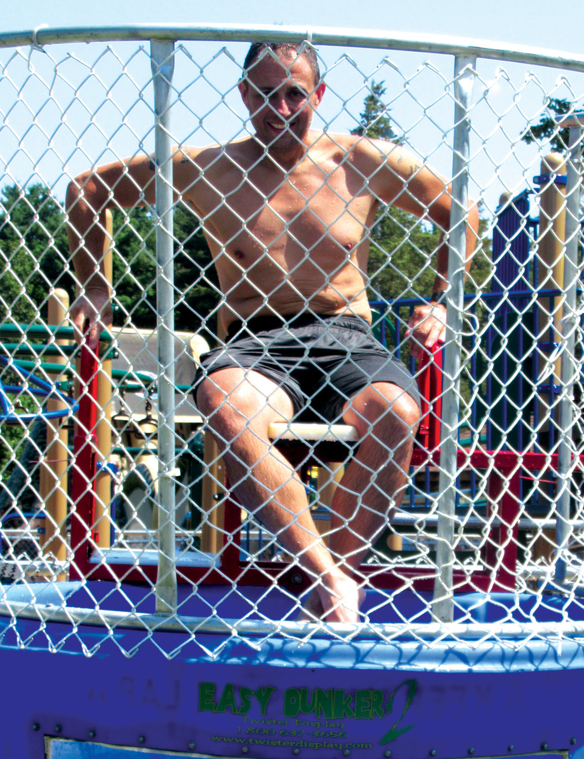 WATER WORK: Sean Senno, vice president of Johnston Youth Football and Cheer, awaits being dropped – again – into the Dunk Tank.