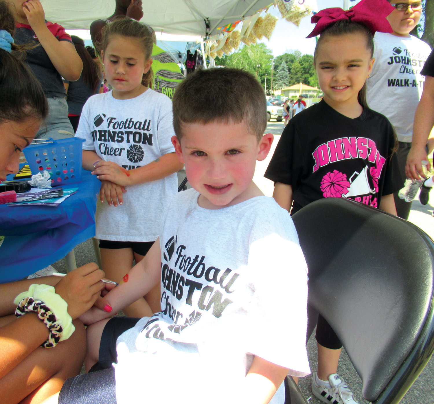 PAINTED PANTHER: Zane Pistachio, one of the new members of the Johnston Panthers Flag Football Division, enjoyed the busy face painting booth at Sunday's Family Fun Day.