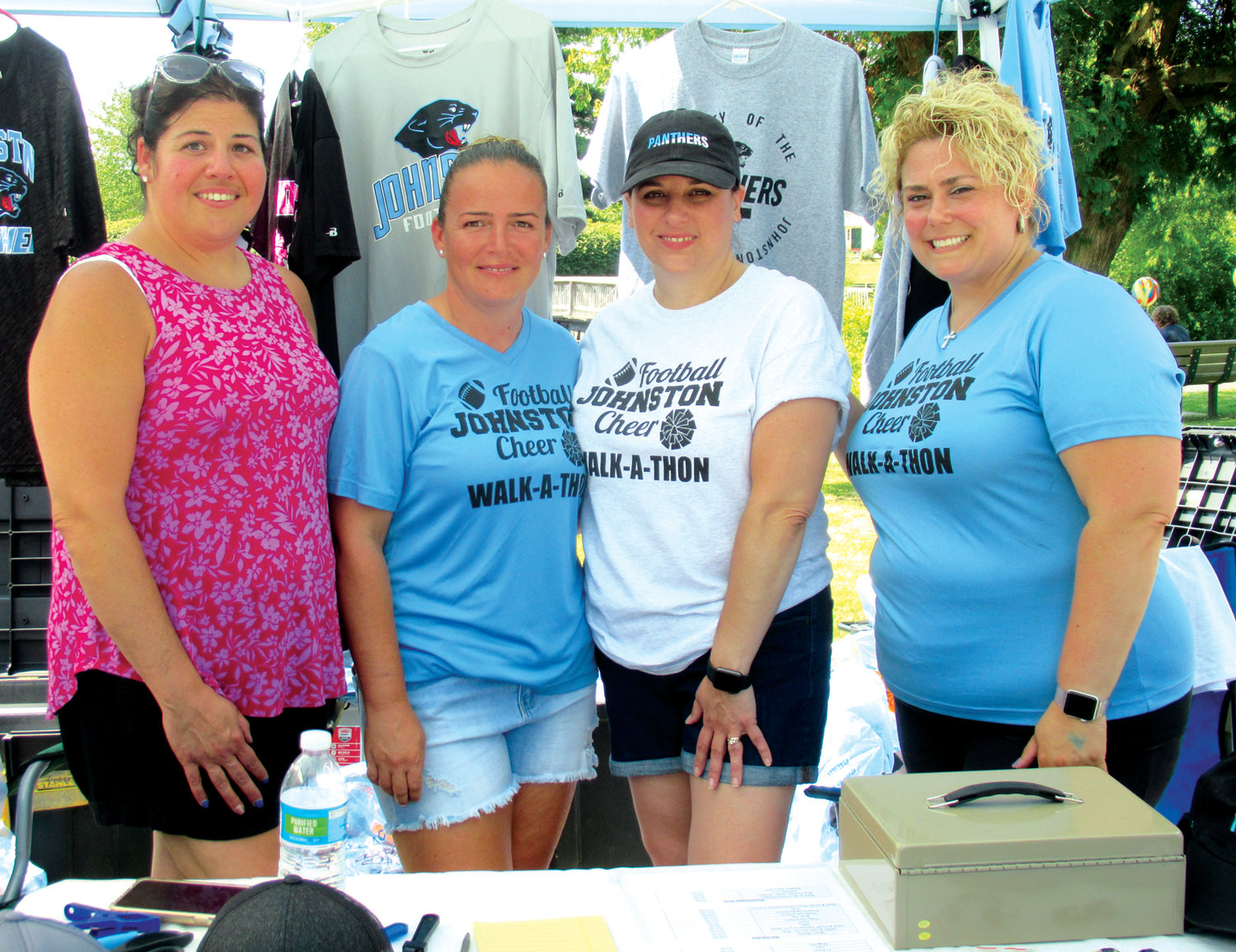 GARB GROUP: Ladies like Jess Testa, Dawn Barry, Bethany Clements and Tar Abbruzzi spend Sunday staffing and selling a variety of Johnston Panthers Football and Cheer merchandise.