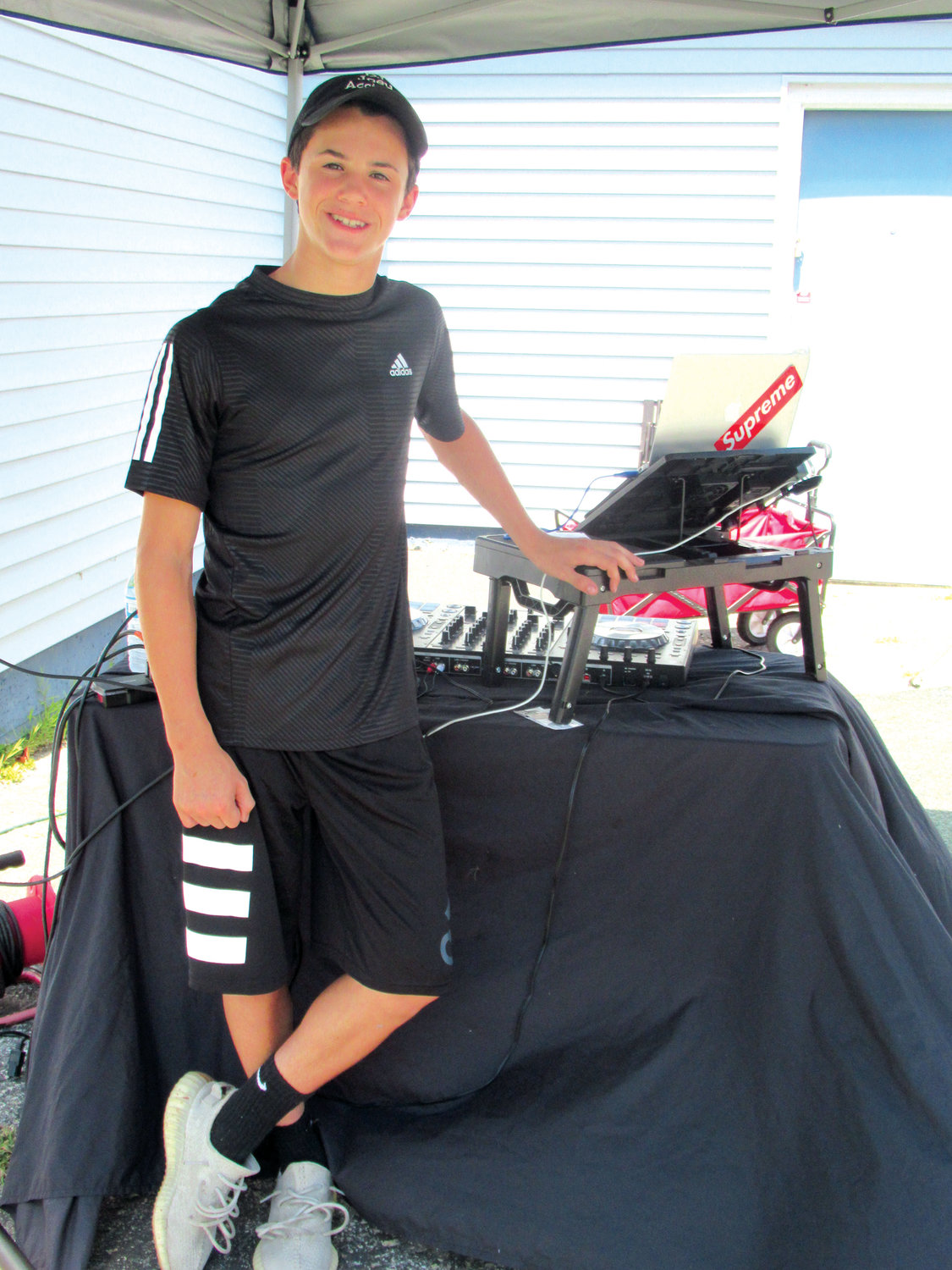 MUSIC MAN: Joey Acciardo Jr. helped make Sunday's Family Fun Day a super success by volunteering his time to play music during the gridiron group's first-ever event.