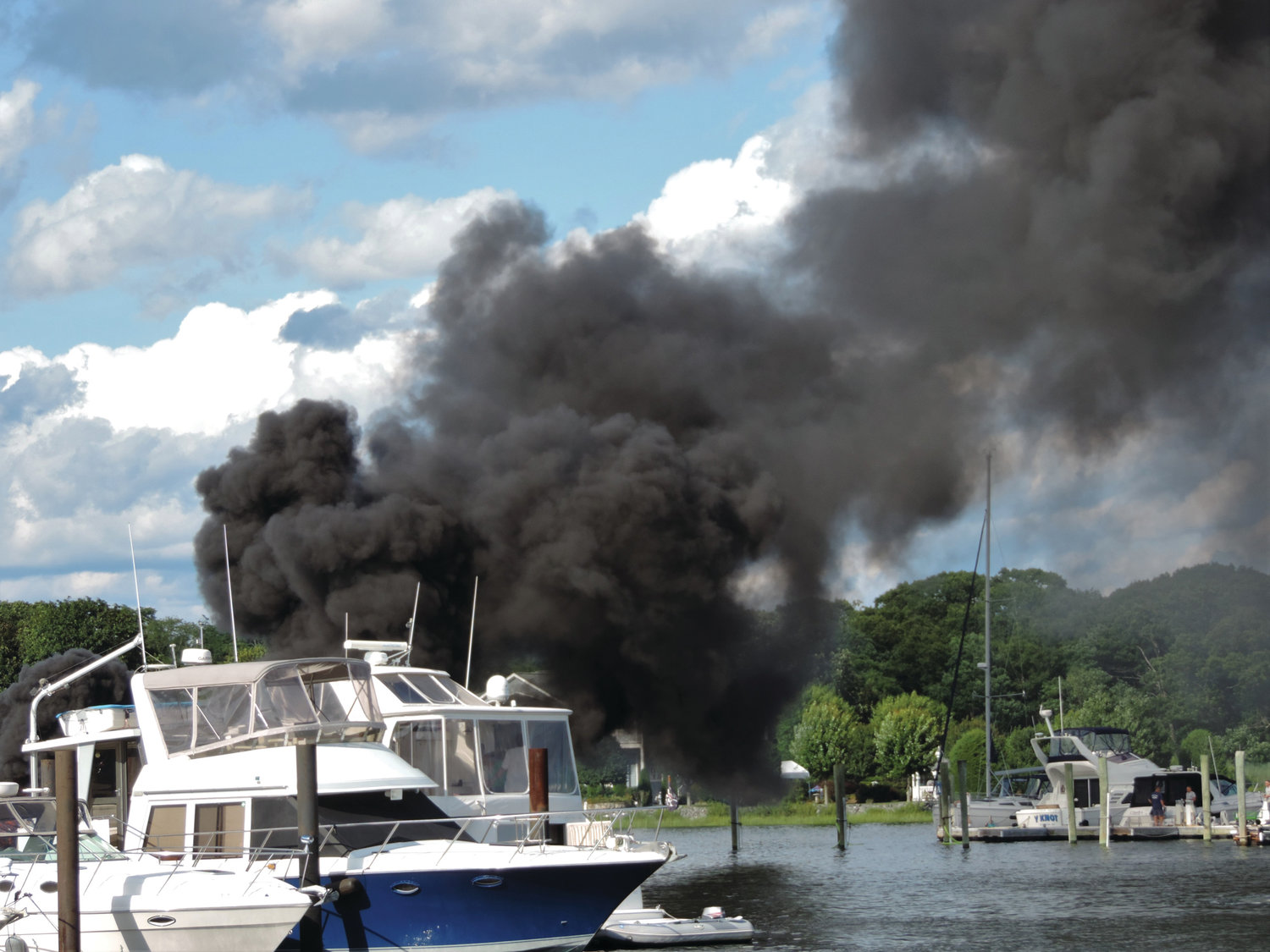 COVE FIRE: Lincoln Smith captured this image soon after a boat exploded in Warwick Cove  Saturday.