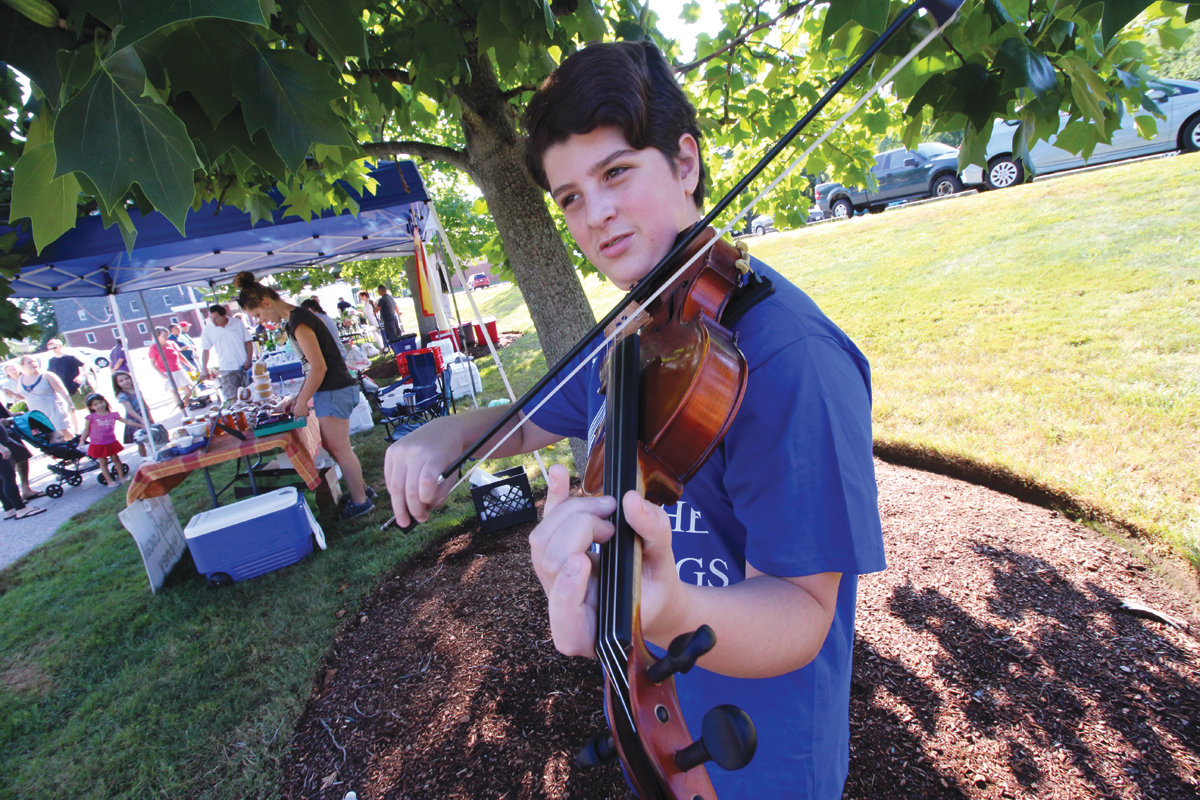 SHOPPING MUSIC: Park View student Liam Derosa regularly performs at the market, often adding a Celtic air to the event.