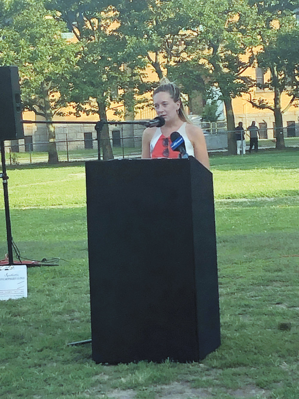UNITED AGAINST VIOLENCE: Katherine Kerwin, Ward 12 Councilwoman from Providence, introduces the Vigil for Change at Dexter Field.
