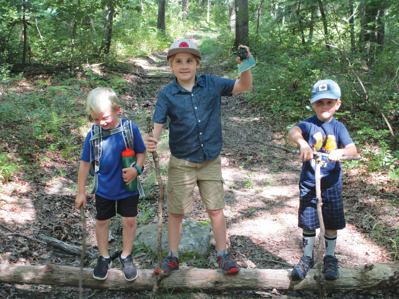 From left, Ryan Cardillo, Vincent Seng and Oliver Seng had fun walking the trail.