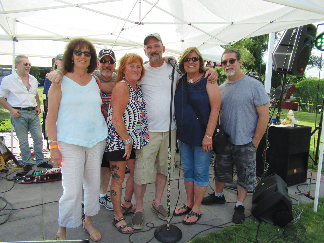 "MEMORIAL MOMENT: During Saturday's fundraiser that raised $4,200 to help homeless veterans, the Mother Bogart & Friends held a tribute to the late Albert M. ""Cookie"" DeLory whose son Scott joined the band during both musical sets. Also taking part were Carol DeLory, Angelo Mann, Lori Eaton, Deb Mangina and Peer Barth."