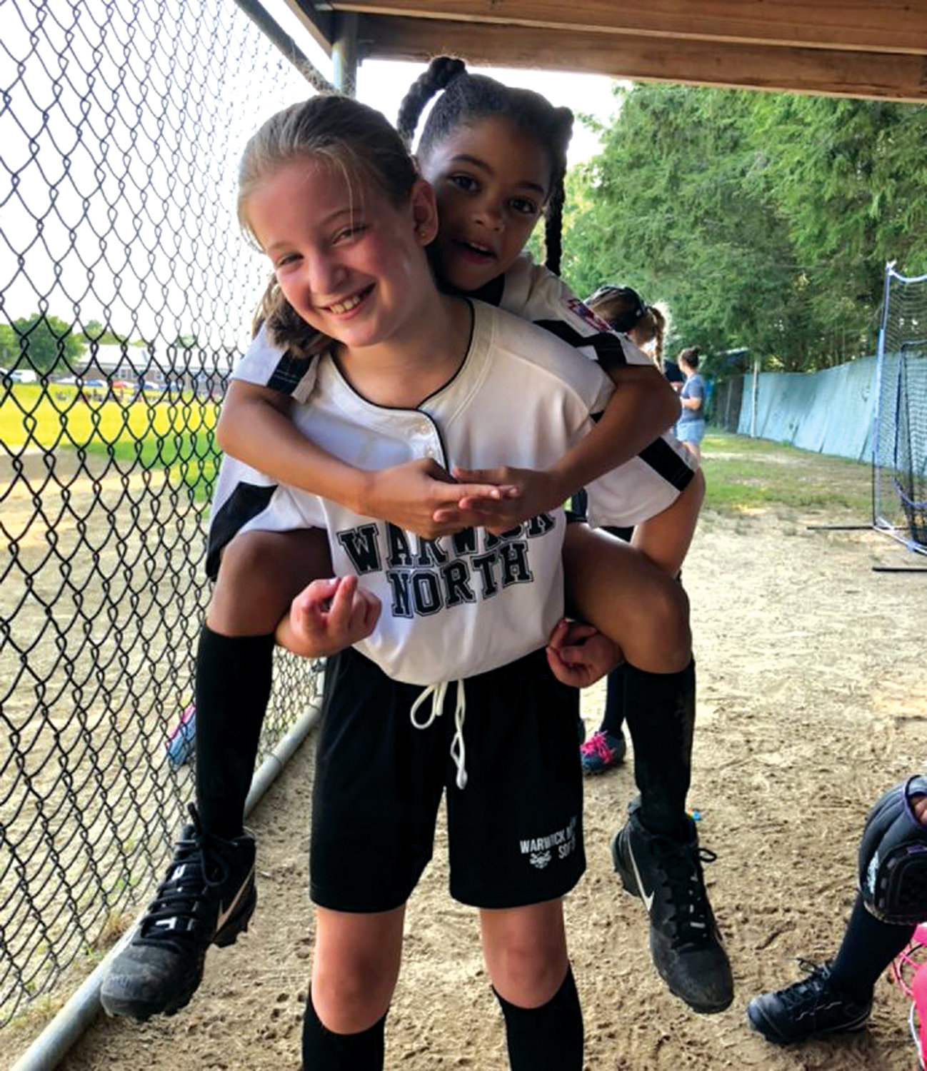 TEAMMATES: Warwick North's Lyla Amitrano and Cienna Fatorma during the state tournament.