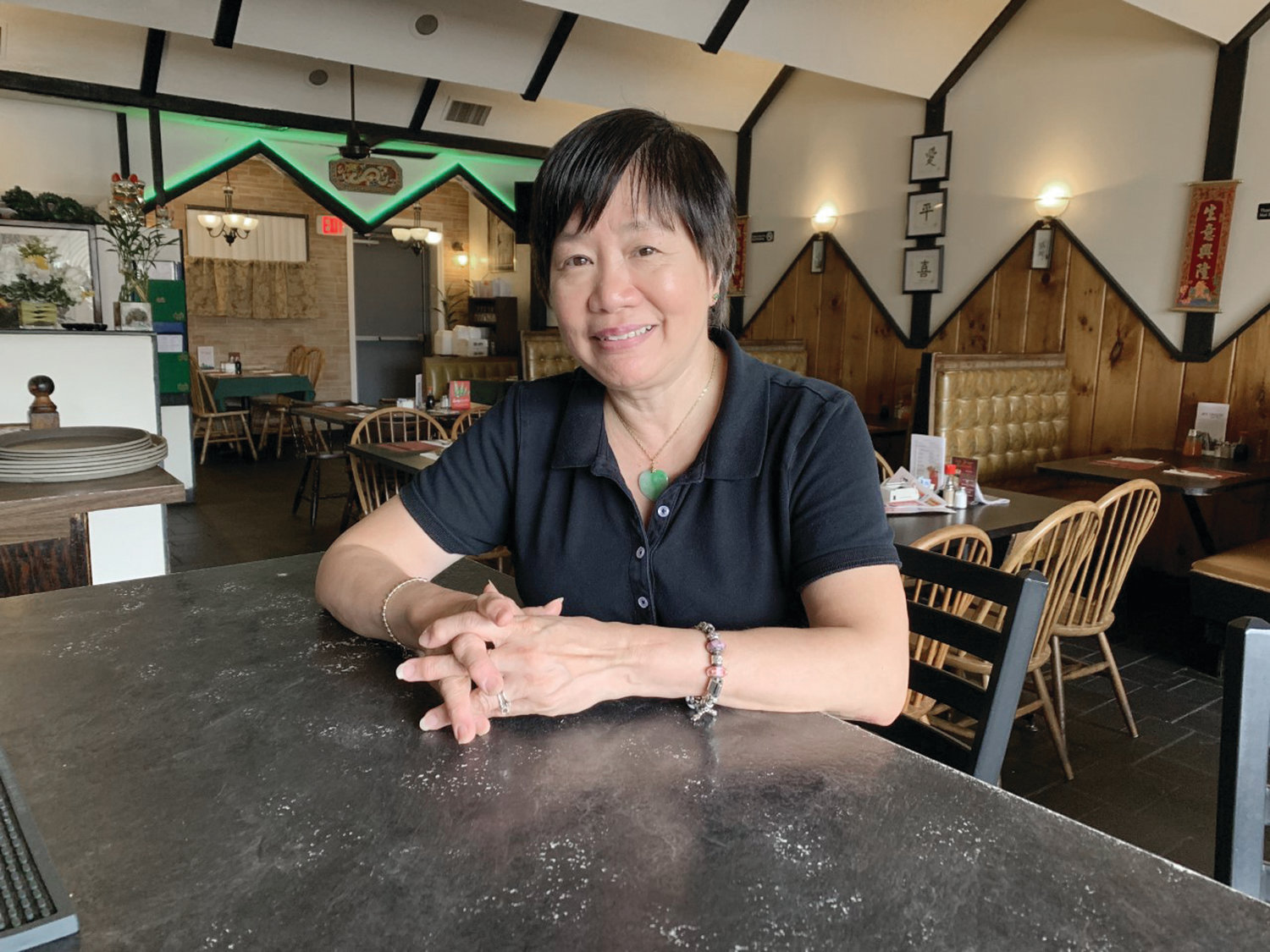 A  lustrous jade stone hangs from a delicate chain around the neck of Judy Chin, the longtime owner of Jade Dragon Restaurant on Warwick Avenue.   The jade stone is a symbol of harmony and balance.