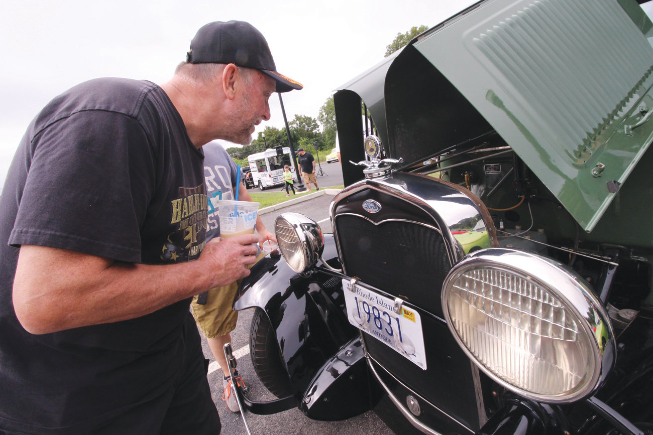 "IT'S SO SIMPLE: Terry O'Rourke, who has worked as a mechanic at several Warwick dealerships and now is at Enterprise marvels at the simplicity of the Model A Ford engine. ""I've put a wrench on many cars, but not this one,"" he said enviously."