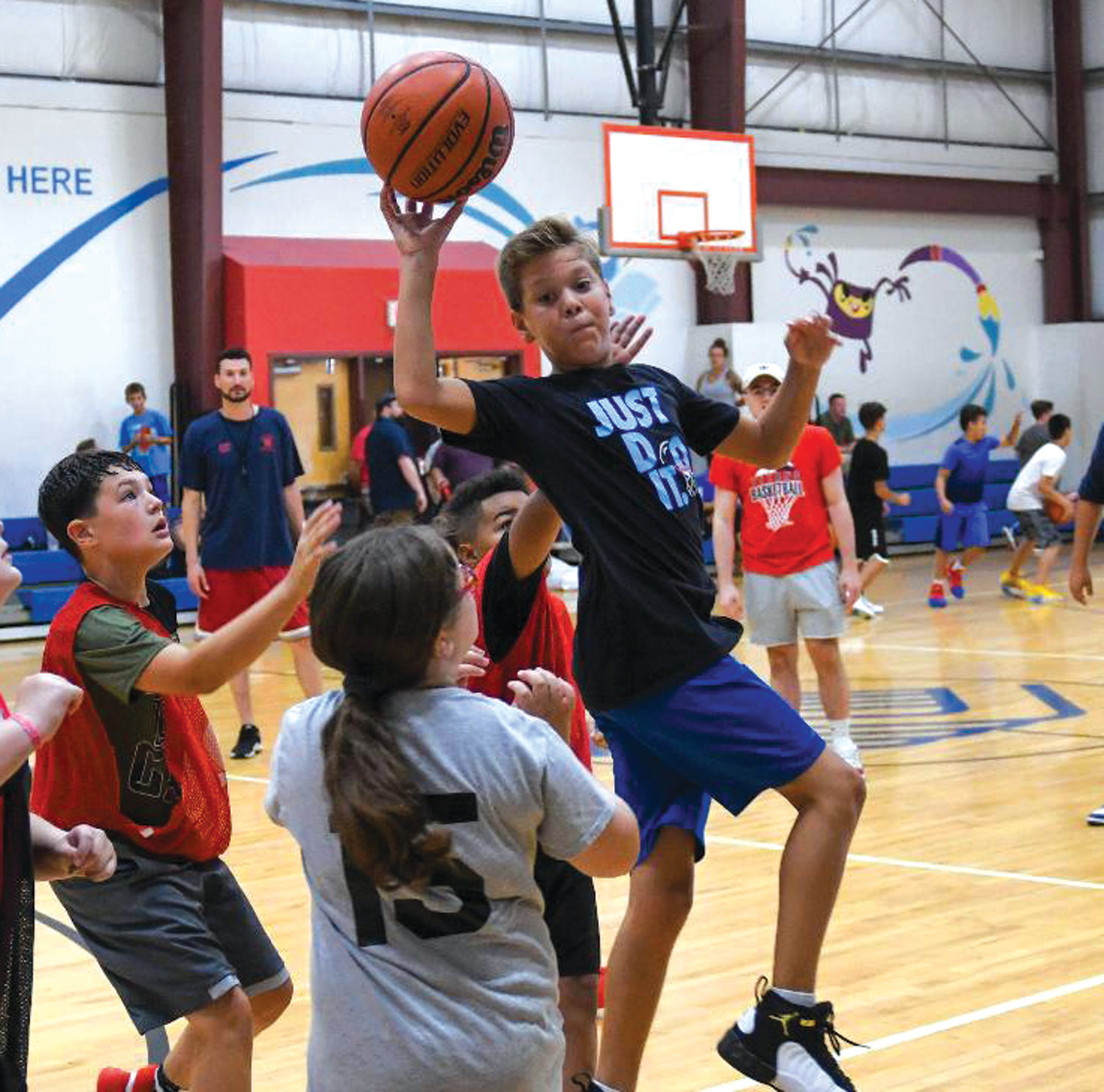 THROUGH TRAFFIC: Andrew Ramos works through defenders at the Warwick basketball clinic.