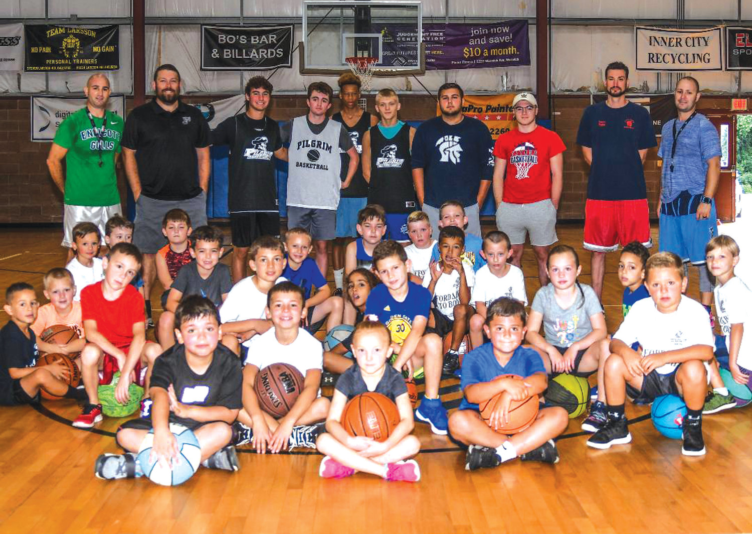 COMMUNITY GATHERING: Locals gather at the Warwick free youth basketball clinic at the Boys and Girls Club on Sunday.