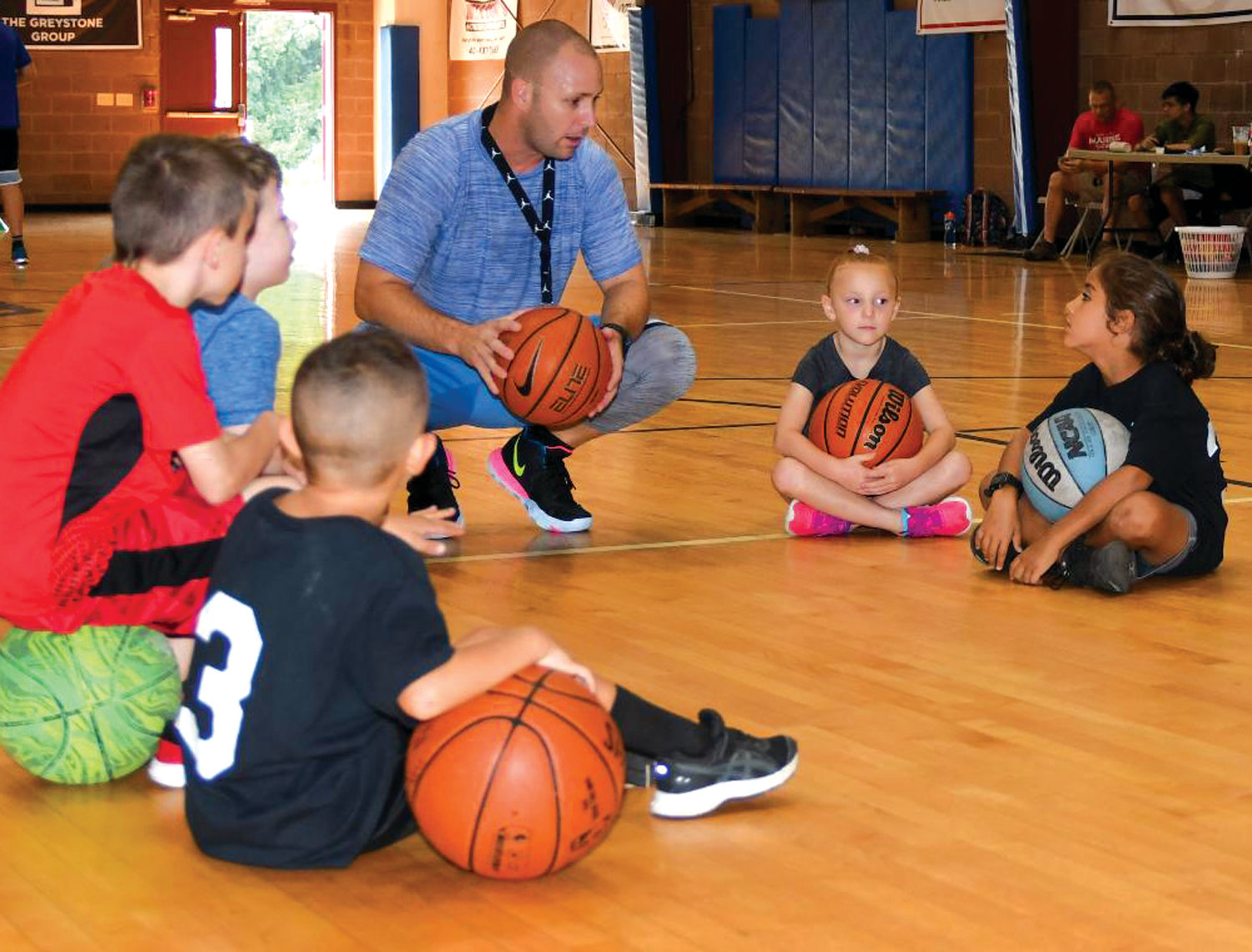 X's AND O's: Former Vets coach Jim Garcia gives some pointers to local youth basketball players.