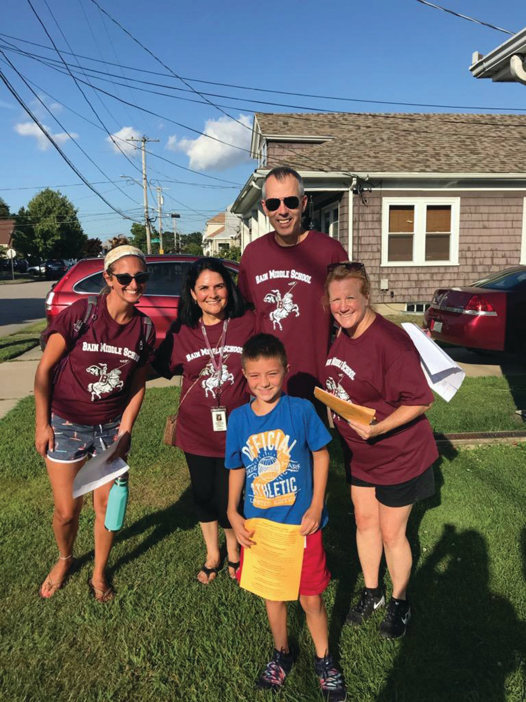 WELCOME TO BAIN: Incoming Bain sixth-grader Gavin Kilduff posed with the team of staff members who visited his house during last week's neighborhood walks, including Assistant Principal Brian Flinn and teachers Michele Dunphy, Tammy Andrade and Rachel Bousquet. (Courtesy of Cranston Public Schools/Jen Cowart)