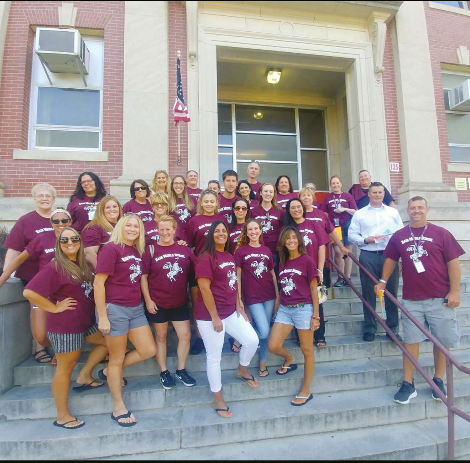 READY TO HIT THE STREETS: Staff members from Hugh B. Bain Middle School, Arlington and Stadium elementary schools, and the Cranston Family Center gathered together for a group photo before heading out last Thursday evening.