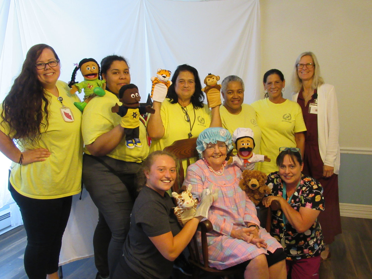 CLEVER CAST: These are the Briarcliffe Manor employees who produced last week's first-ever puppet show that was designed exclusively for residents with dementia.
